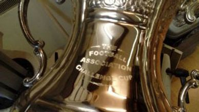 large silver cups engraved