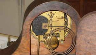 mechanism in an antique mantle clock