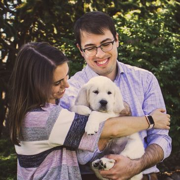 Project Photo Studio pet portrait of a family holding a puppy