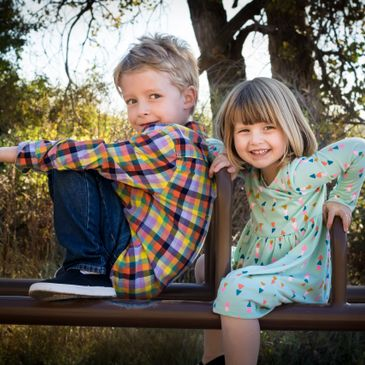 Project Photo Studio family photo of two kids on a playground