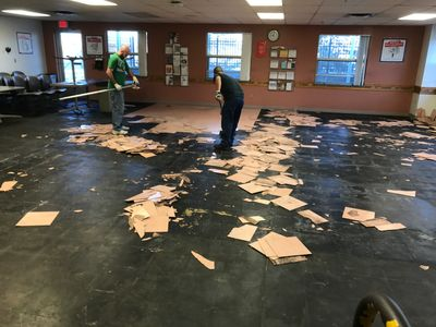 Home Improvements - tearing out old tile for preparation of new flooring in Terre Haute, IN