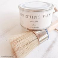 Jolie finishing wax can on a round wax brush.