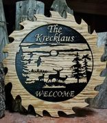 Wooden sign with wildlife images and cut like a saw blade