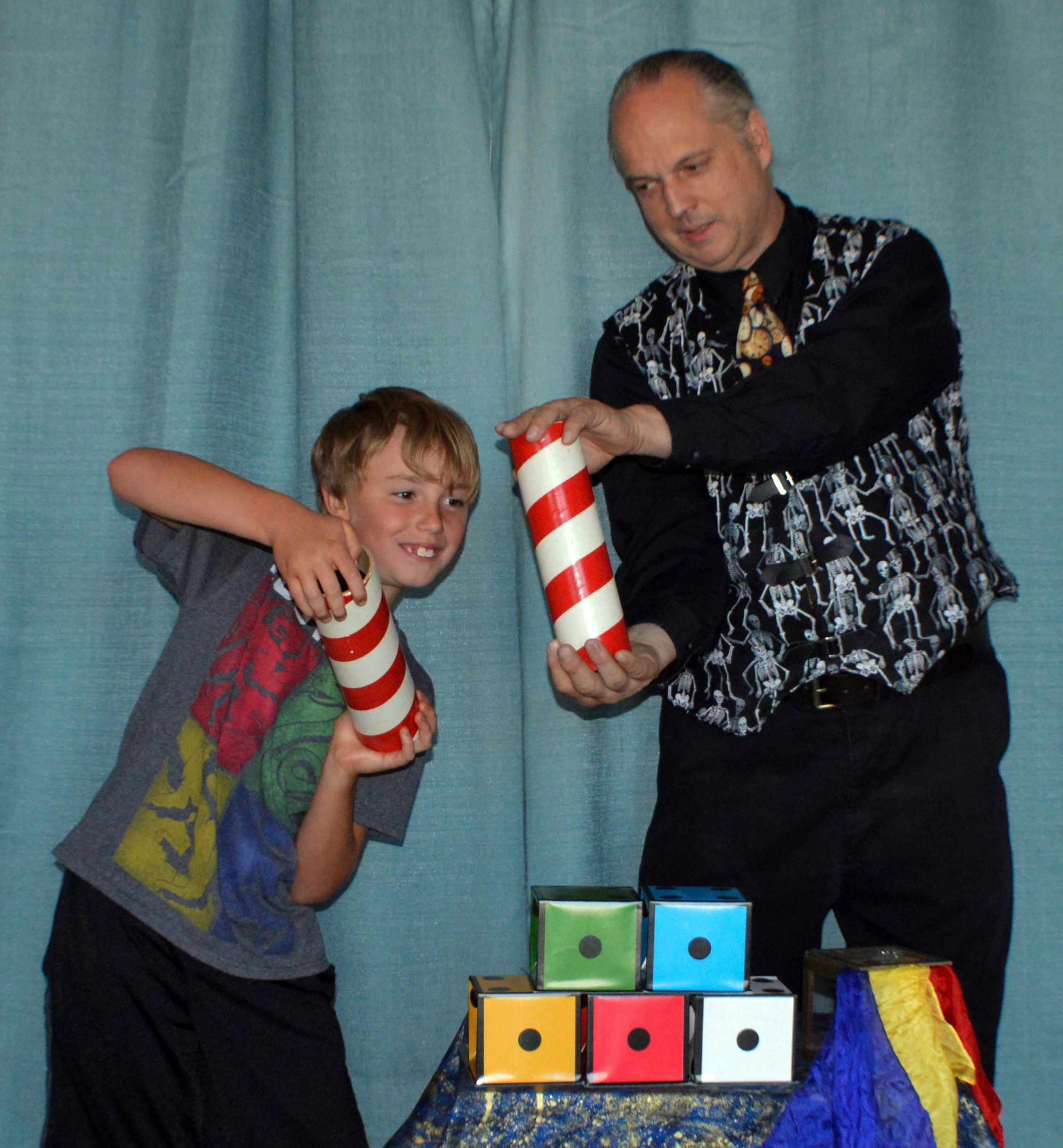 Performing the audience participation comedy magic trick Topsy Turvy Bottles with my great nephew.