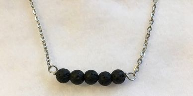 Lava stone bar necklace. Add a drop of your favorite essential oil for an all day pick me up!
