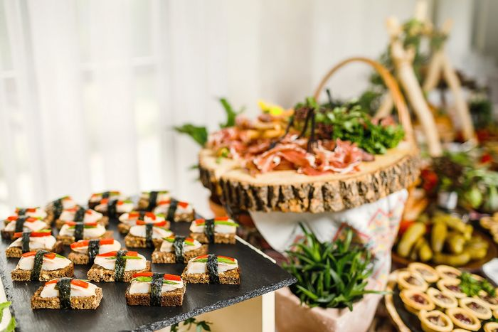Catered appetizer buffet with canapes and finger foods.