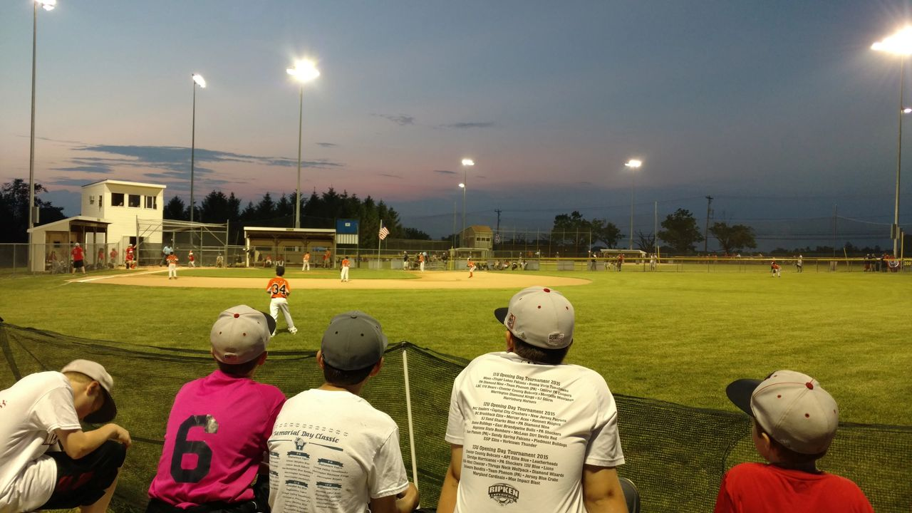 """12 year old players from Warrington Youth Baseball watch the 10u pool game between Warrington and Lenape Valley during the 5th annual Warrington Youth Baseball Memorial Day Tournament..  Field lights were recently installed at Barness Park, through a nonprofit/local government partnership, allowing for hundreds of youth baseball players the thrill of playing """"under the lights"""", and easing busy parent/family schedules.  For more information, please visit www.warrington-baseball.com."""