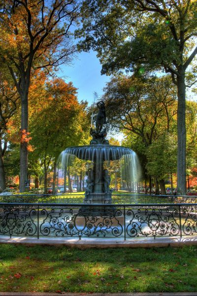 Water Fountain with fall foliage..