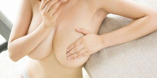 Toronto Asian Massage. Large breast Asian massage girl in Toronto hotel room.