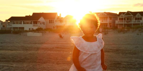 Child on the beach during sunset