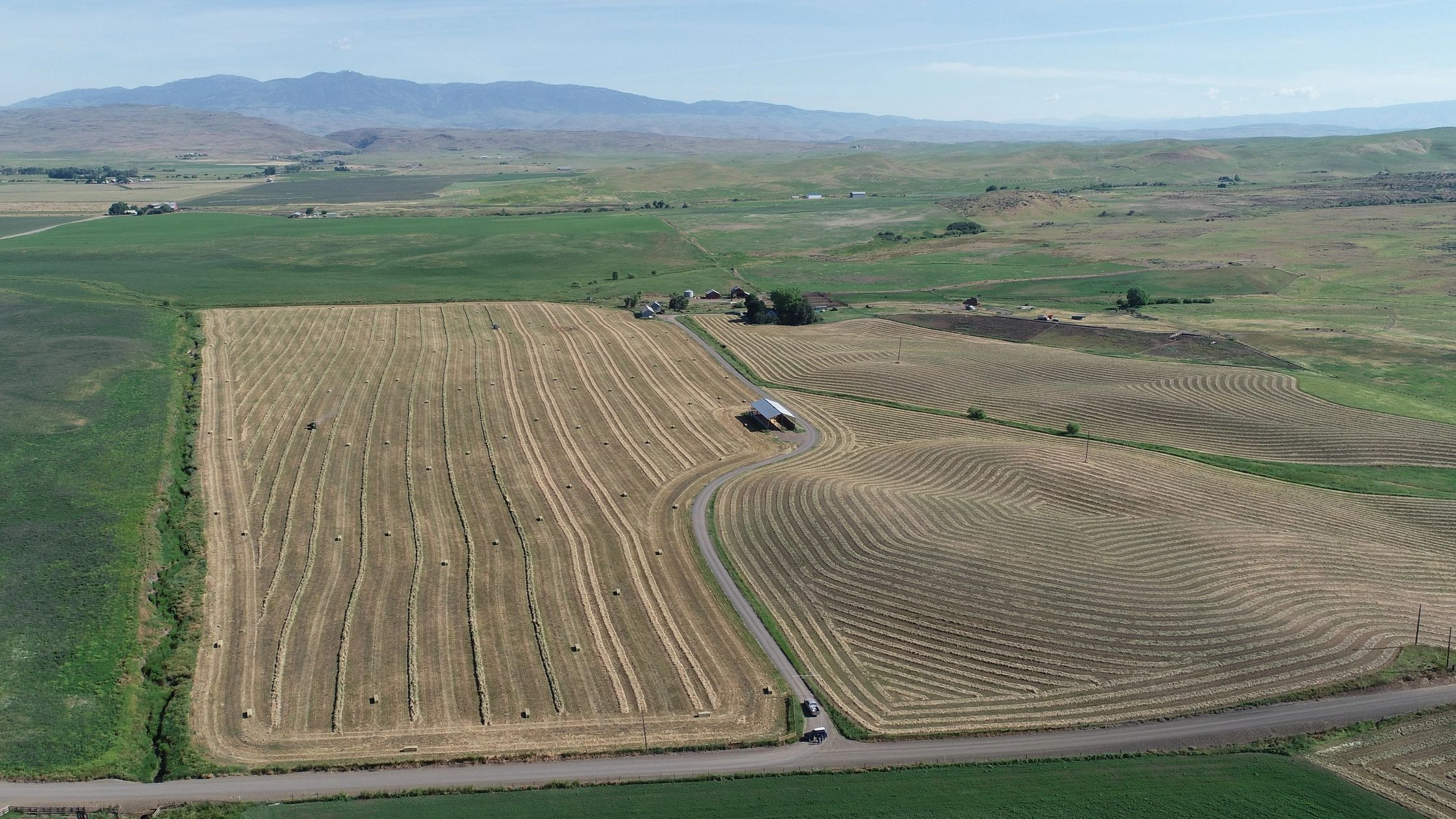 Hay field being raked and baled outside of Midvale, Idaho - SX Ranch