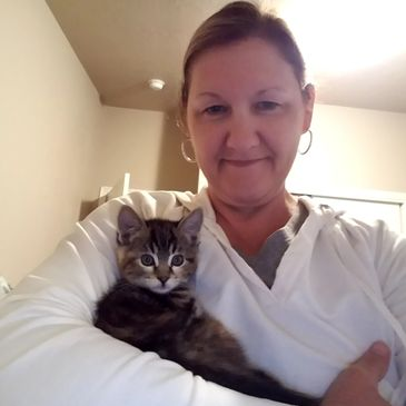 Pet sitter/owner with a client kitty
