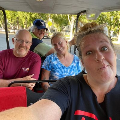 puzzlemaster with riders on puzzle ride golf cart