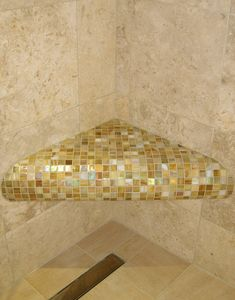 Glass mosaic seat in shower steam room . East grinstead . Tiles supplied by original style .