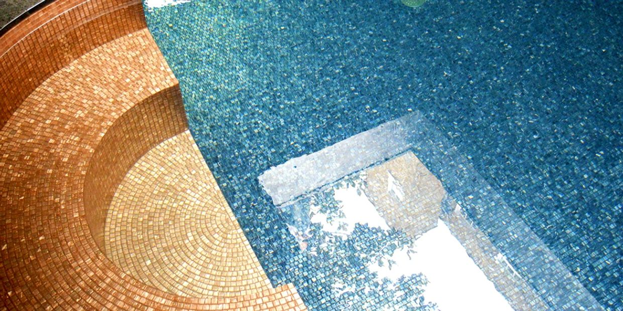 Bronze glass mosaic seating London. Tiles supplied by Bisazza . London swimming pool design .