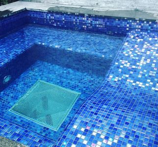 Glass Mosaic spa jacuzzi in Keston in kent . Blue iridescent Mosaic supplied by Trend mosaic,