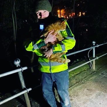 A CitySafe Nighttime Economy Medical Support Volunteer holding a cat in Durham City