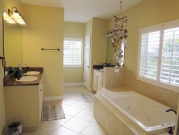 The master bathroom suite on the second floor - three basins, bath, separate WC and awesome shower