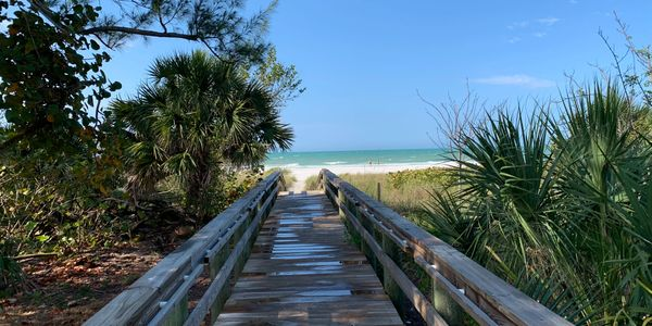 Drawn to the beach? Just one of the easy paths to the glorious sandy beaches of Anna Maria Island