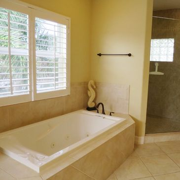 The second floor master bathroom suite with bath and (awesome) shower cubicle showing