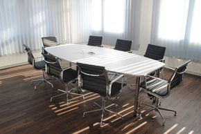 Office conference room with empty chairs.