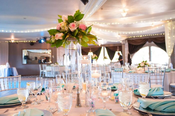 Wedding table setup with beautiful centerpieces and floral decor.