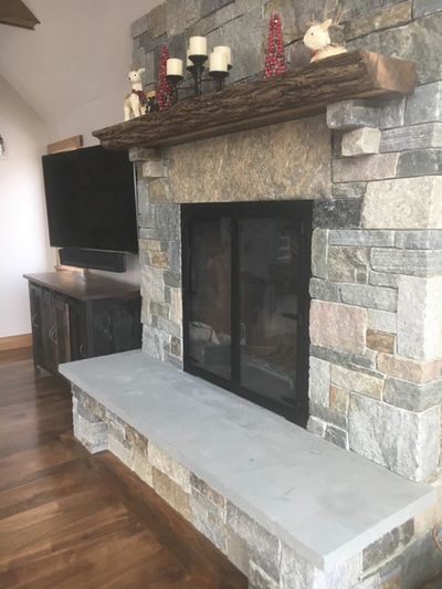 Stone Fireplace with Live Edge Wood Mantel, Custom Fireplace Doors and Blue Stone Hearth
