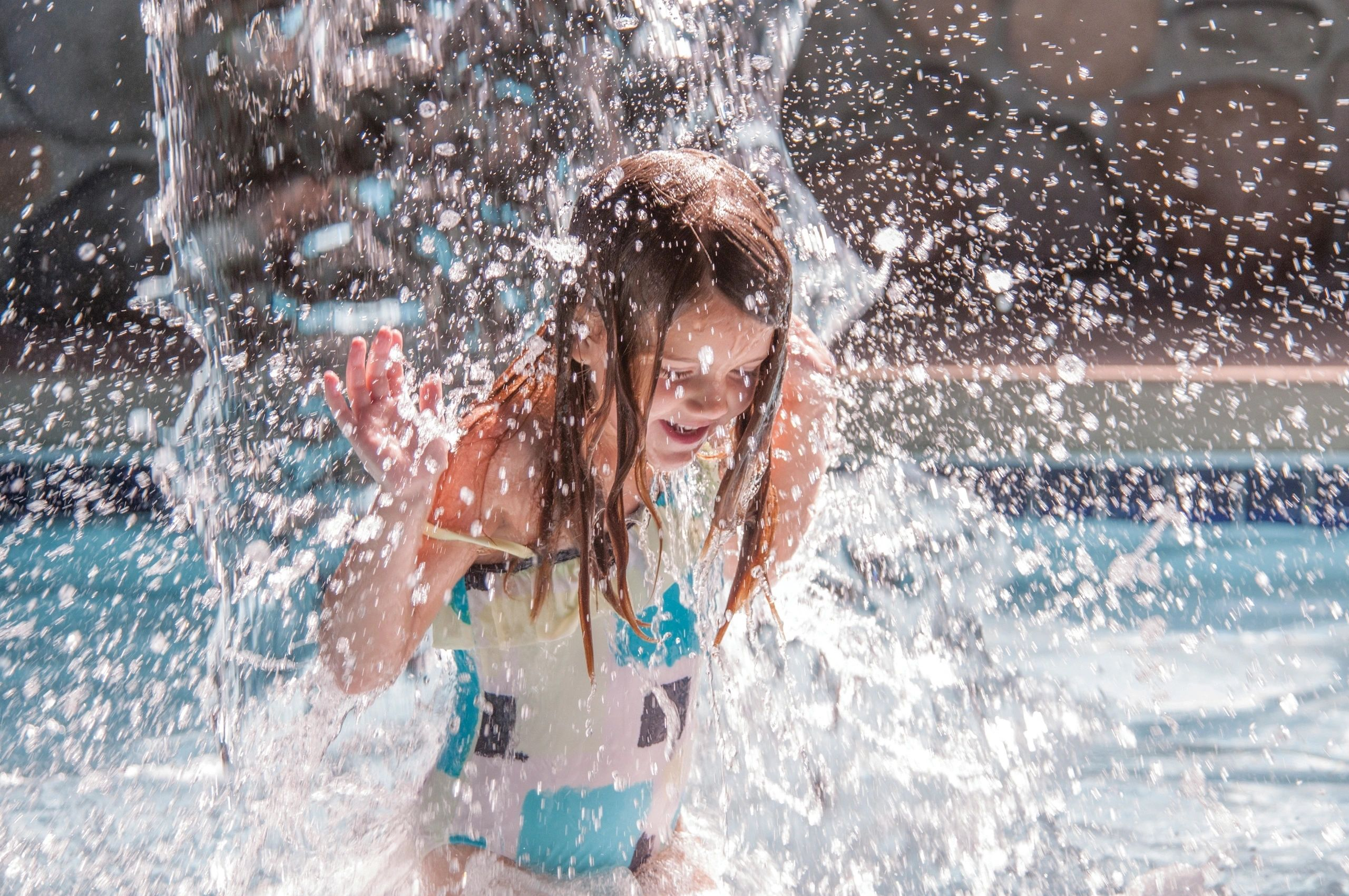 girl splashing in water in the indoor waterpark