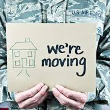A soldier holding a sign that says we are moving.