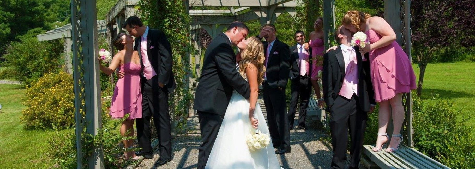 bride and groom kiss after their wedding ceremony performed at the vineyard
