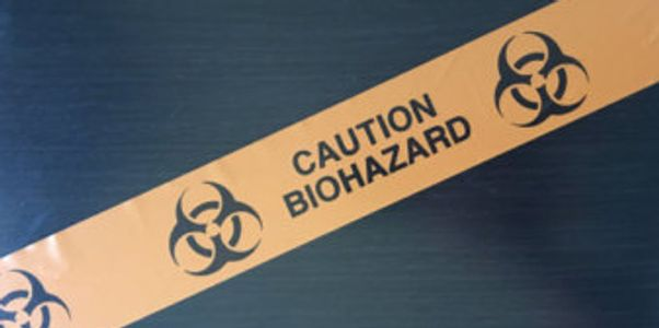 Biohazard tape cautioning people to stay out.