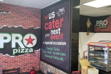 Custom vinyl lettering for Pro Pizza's company walls and building