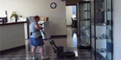 Michelle buffing front lobby in Champaign Illinois