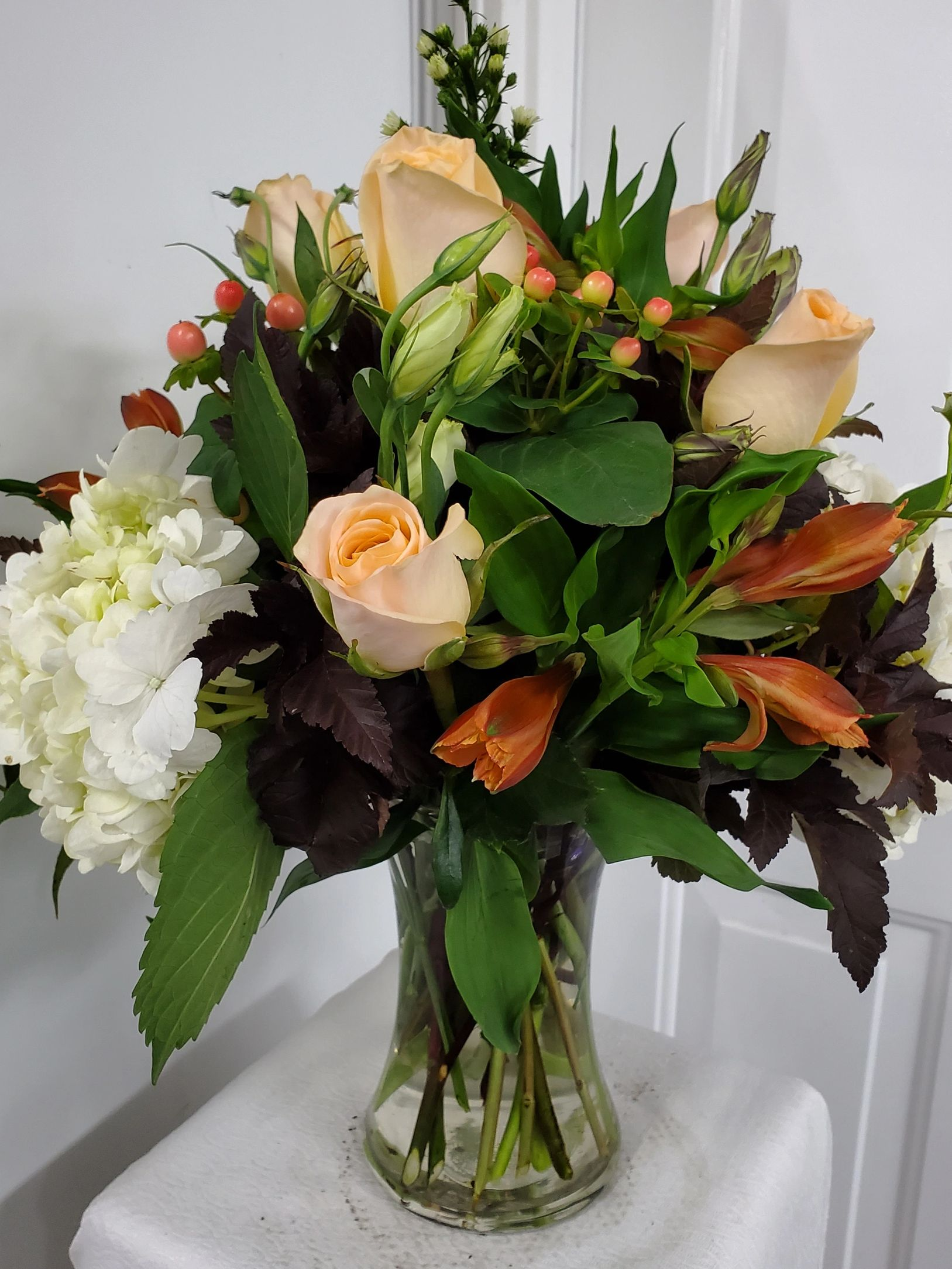 Fall floral arrangement in clear vase