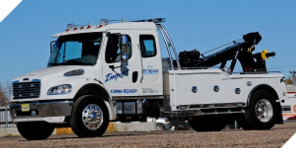 dump truck towing, RV towing, boat towing, trailer towing, motorcycle towing, RV towing
