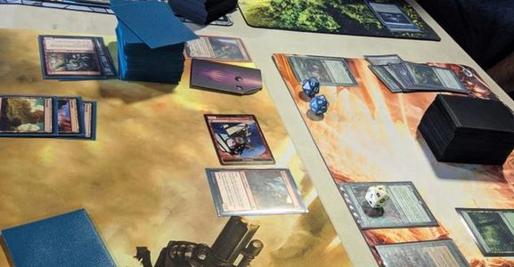 Play Magic the Gathering organized play events like commander or Friday Night Magic.