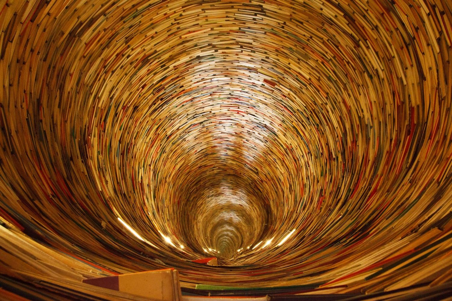 A book tunnel in Prague's library. Yes, mirrors are used to create this effect.Petr Kratochvil. CCO.