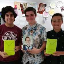 Image of students with some reading revolution books