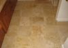 Heated Travertine floor with small clipped corner inserts.