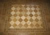 Tumbled Travertine floor with a bordered inlay of alternating colors.