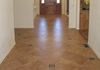 "20"" Porcelain tile on a diagonal with random bronze clipped corner inserts."