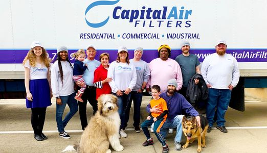 Capital air filters employee team and air filter delivery truck