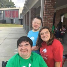 A couple friends with disabilities with one of our best volunteers