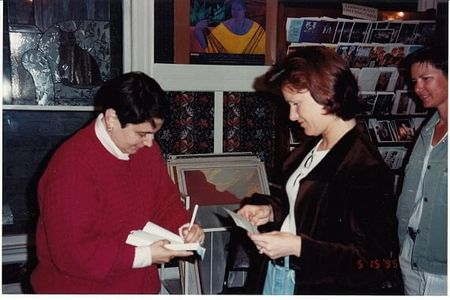 Karla Jay signs books at a book signing.