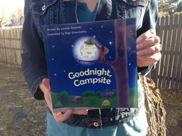 "Kids Camping Books Author Loretta Sponsler holding her debut book ""Goodnight, Campsite"""