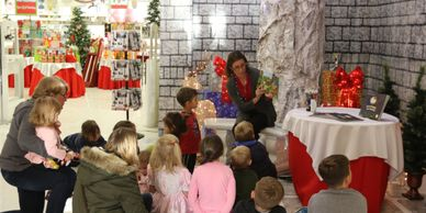 Kids Camping Books Author Loretta Sponsler reading to children at a holiday event