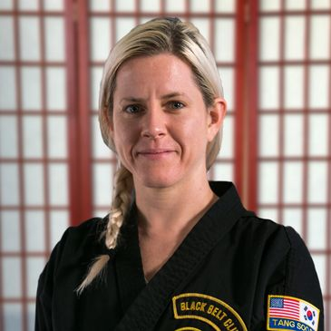 Bu Kyo Sa Nim Gassett is a lead instructor in our Tang Soo Do program. She is a first degree black belt, or sho dan, and does an excellent job teaching the kids and adults.