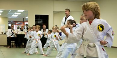 A group of kids doing their best at their karate belt test. This group is ages 4-6.