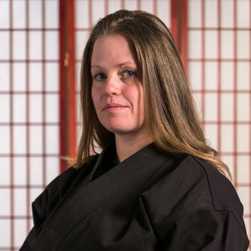 Kerri Mikita is the owner of California Karate Academy. She is a third degree black belt, or sandan, and a blue belt in Brazilian Jiu Jitsu.