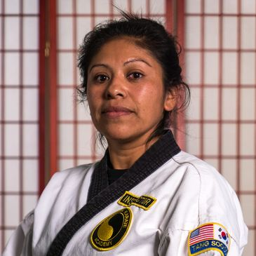 Kyo Sa Nim Arango is a third degree black belt, or san dan, in Tang Soo Do and is one of our lead instructors. She is excellent with the kids and adults.
